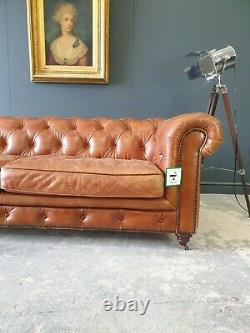321. Ex Display Large Vintage Tan Leather Three Seater Chesterfield Sofa
