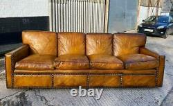 A Huge Four seater vintage Tan leather sofa with studs Made in England
