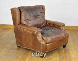 Aged brown tan leather wingback fireside tub chair armchair